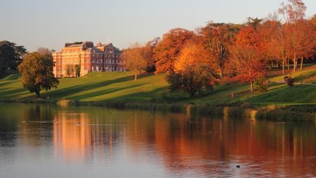 View across the lake to Brocket Hall, Hertfordshire in autumn
