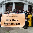 Faith leaders outside of the Golders Green Hippodrome with banner in support of the Markaz El Tathgheef el-Eslami group