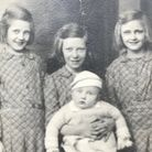 Brian as a baby with histhree youngest sisters