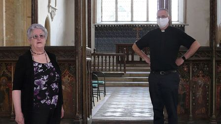 LynFairchild, church warden at Saint Agnes in Cawston and rector Andrew Whitehead.