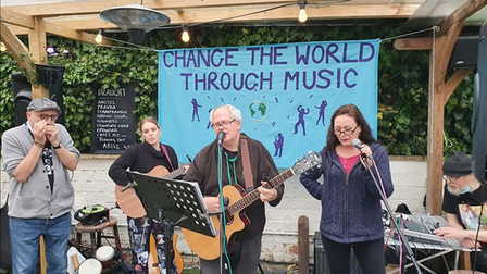 Musicians at Change the World Through Music event with organiser Richard Lafford centre on guitar.