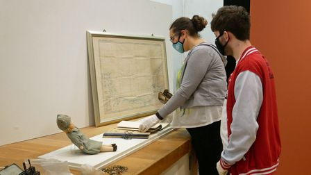 Project curator Clare and volunteer Harry laying out 'secret' objects chosen by the public