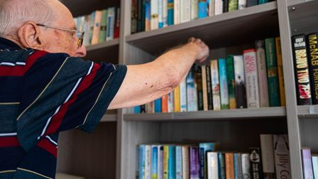 ResidentRoy Ketchell, 88, organises the books in Foxholes Care Home's brand new library