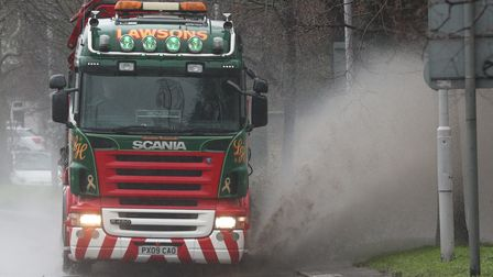 A lorry going through a puddle on the A4 Great Western Road in Chiswick, west London. Picture date: