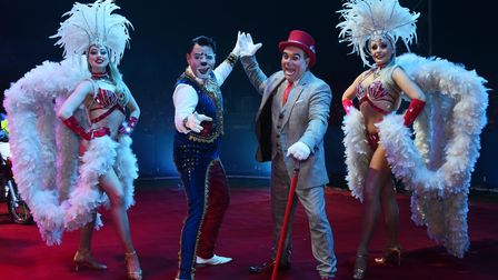 Edy the Clown, second left, and Angelo the Clown, with Olena Nicnikulina, left, and Liudnyla Virncea