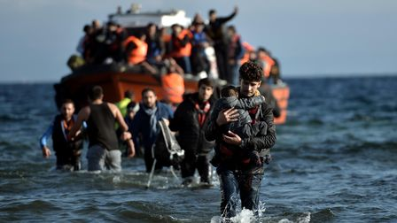 Refugees and migrants arrive on the Greek Lesbos island after crossing the Aegean Sea from Turkey on