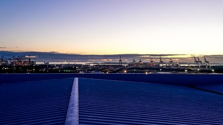 A picture taken from the top of the new Uniserve warehouse looking out over Felixstowe docks at night.