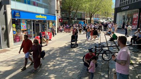People enjoy the sunny weather in Norwich.