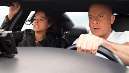 Letty (Michelle Rodriguez) and Dom (Vin Diesel) in F9, directed by Justin Lin.