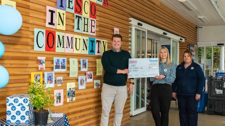 Craig Billington from Arc receives vital funds from Tesco in Axminster