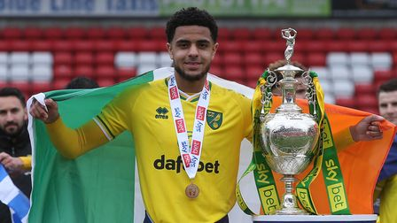 Andrew Omobamidele of Norwich with the EFL Championship trophy at the end of the Sky Bet Championshi