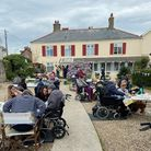 Residents and families enjoy a tea party at The Seaton care home