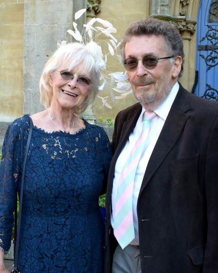 Guests Barbara Lord and husband Robert Powell at the wedding ceremony of Marjorie Wallace and John Mills