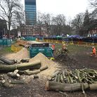 Workers cleared felled trees next to the anti-HS2 camp at Euston Square Gardens, London, on Monday,