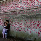 Brother and sister Amira, three, and Adem Atia, four, at the Covid Memorial Wall, on the Embankment