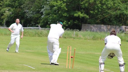 Aaron Johnson takes a wicket for Yelling Cricket Club.