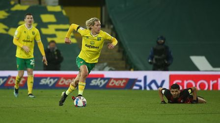 Todd Cantwell of Norwich in action as leaves Dominic Solanke of Bournemouth on the floor after going