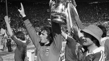 Paul Cooper and Mick Mills show the FA Cup off to Town fans at Wembley in May 1978