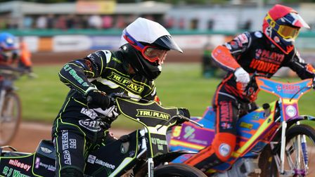 Rory Schlein charges up the inside of Danny King in heat four.