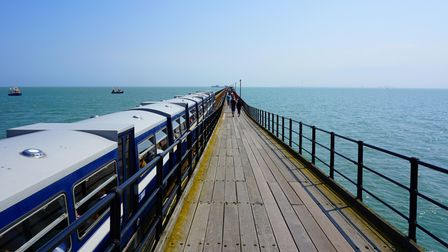 Picture of Southend-On-Sea Pier converging into the horizon.