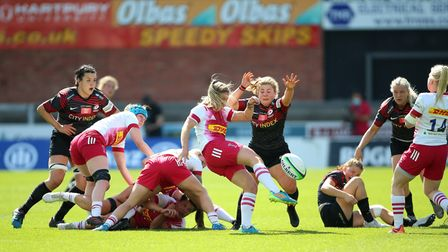 Saracens' May Campbell charges down the kick from Harlequins' Leanne Riley during the Allianz Premie