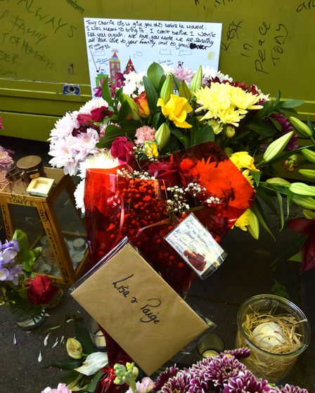 One of the many tributes taped to Tony'sflower stall on Essex Road.