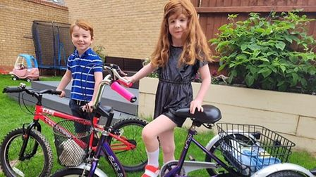 Isla Hastings is picturedwith her new trike and her brother Dylan.