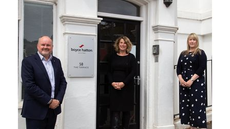 Three solicitors outside offices