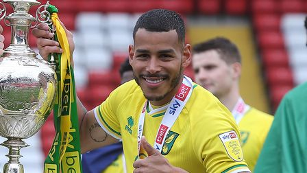 Ben Gibson of Norwich and Onel Hernandez of Norwich with the EFL Championship trophy at the end of t