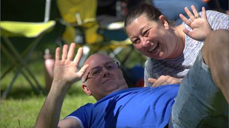 Couple waving to the camera at Friends of Wisbech Bandstand concert