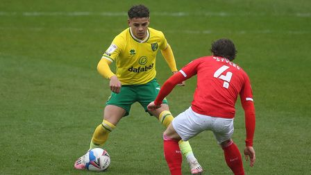Max Aarons of Norwich and Callum Styles of Barnsley in action during the Sky Bet Championship match