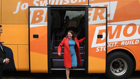 Liberal Democrats leader Jo Swinson reacts as she exits the party's campaign 'Battle Bus' in north w