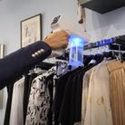 A video still showing Nikki Anthony of Wardrobe boutiquein Great Dunmow, sanitising clothes