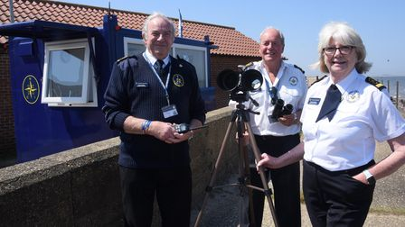 The National Coastwatch team with the trial mobile unit set up at the Golf Club above Brancaster bea