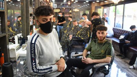 Hamoud Hashim, 22, opens his new barbers, Brothers Barbershop, with free haircuts on the opening day