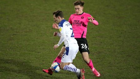Tranmere Rovers' Lee O'Connor (left) and Peterborough United's Flynn Clarke battle for the ball duri