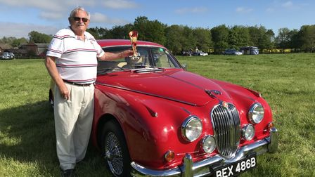 Charles Gibbons and his winning 1964 Jaguar at the Stody Classic Vehicle Day.