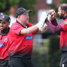 Adeel Malik of Hornchurch celebrates with his team mates after taking the wicket of Tom Oakley durin