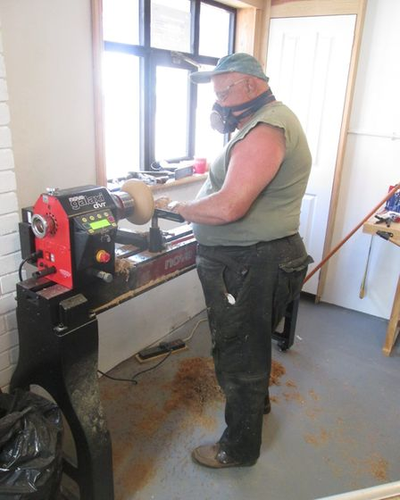 Bernie Clark working on a wood lathe at the Stalham Men's Shed.