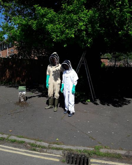John and Victoria Squires in full kit to catch the swarm near Eaton Park on Sunday during the Bank Holiday weekend