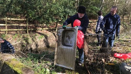 Friends of Audley Park volunteers remove an abandoned sink in their clean-up