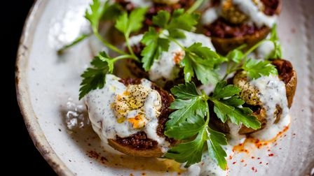 Spiced lamb 'jackets': fried potato skins filled with spiced lamb,served withmint yoghurt