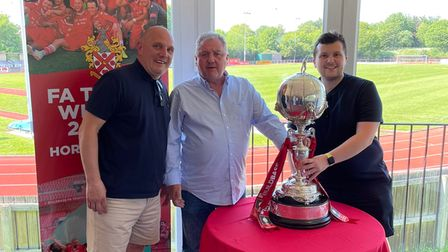 Hornchurch fans celebrate with the FA Trophy at Bridge Avenue