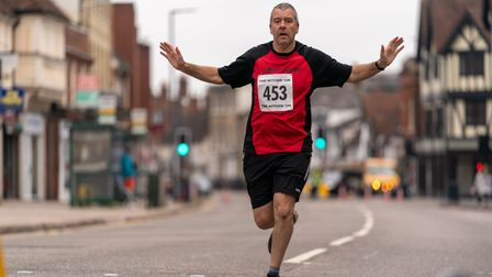 A runner races down Bancroft as part of the Hitchin 10k on Sunday
