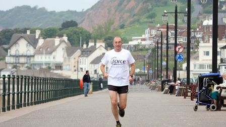 John Keast traing on Sidmouth esplanade before his 70 mile run in a day. ref shsp 3006-19-11TI Click