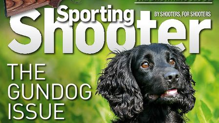 The cover of Sporting Shooter's July issue showing a black cocker spaniel