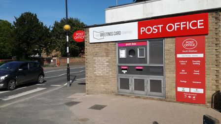 North Walsham Post Office where the former ATM hole has been bricked up.