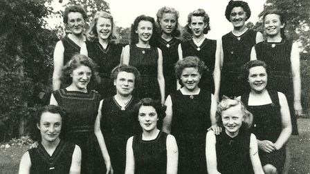 A group of young women pose for a photo.