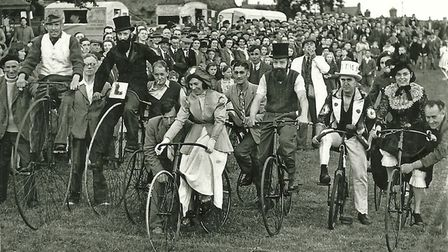 A large crowd of people take part in a bicycle race