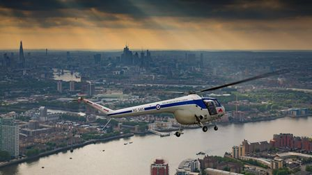 A helicopter flying over London